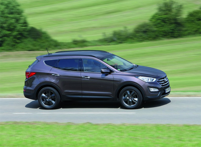 Фото Hyundai Santa Fe 2013 - Вид сбоку
